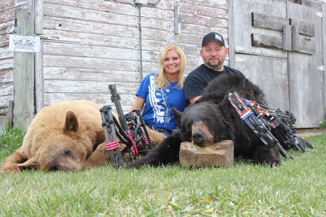 Happy couple with two good bears