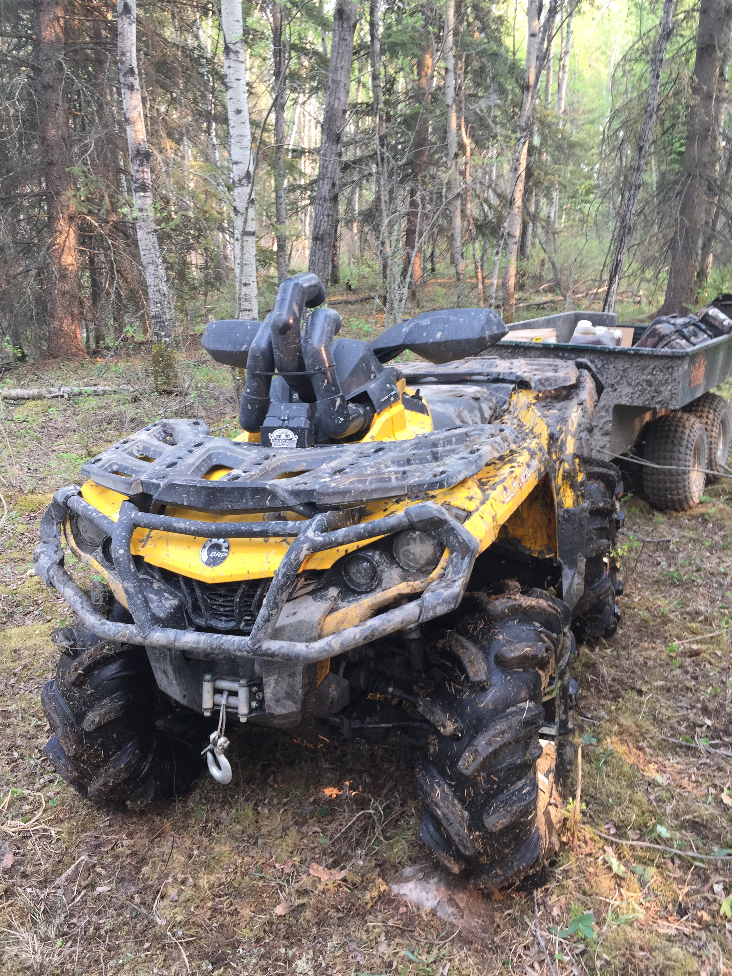 one muddy quad and trailer