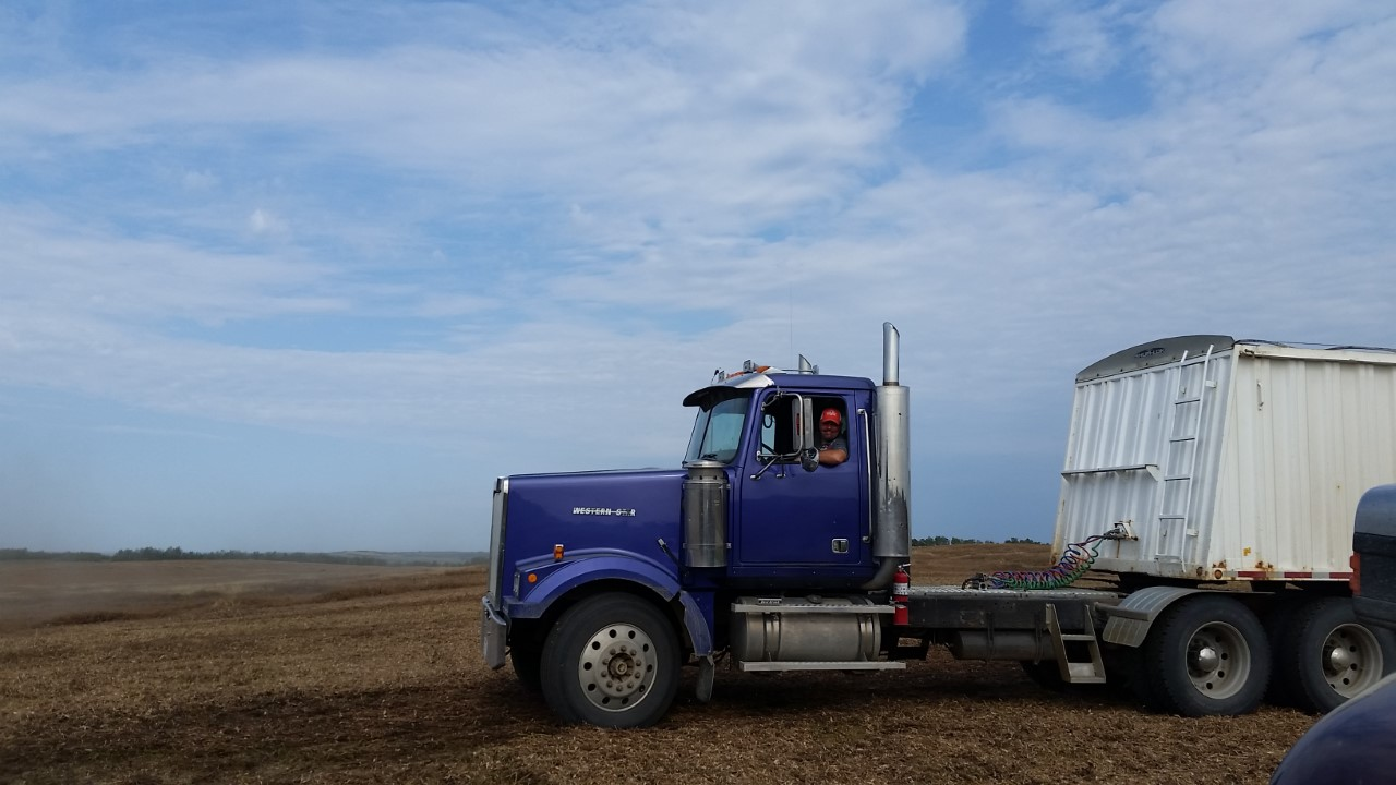Grant bringing one of the semis across to the field